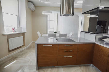 View of luxury expensive modern fitted kitchen with stainless steel appliances. Design of the kitchen room. Imagens