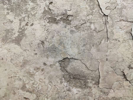 Grey Concrete Texture old wall background with peeling paint, scratches and cracks