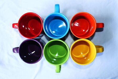 empty assorted colorful mugs suitable for loving couples