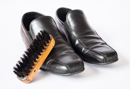 Business shoes with shoe polish brush on white background Stock Photo - 21543522