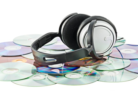 Headphones on the background of the CDs Stock Photo - 17755469