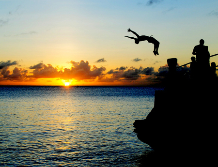 mariana: A boy summersaults off a ledge at Taga Beach on Tinian, Northern Mariana Islands.
