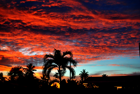 Skies on fire  Skies on fire at sunset is a common sight people and visitors of the Northern Mariana Islands are blessed with. Stock Photo