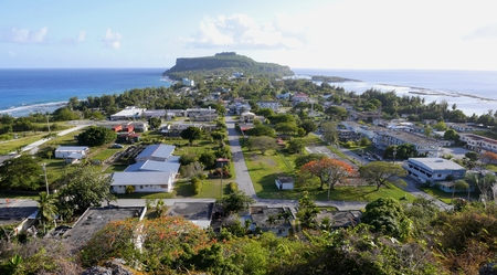 Songsong Village, Rota The village of Songsong, Rota in the Northern Mariana Islands, viewed from the Rota Overlook. At the far end of the village is the Wedding Cake Mountain. The village is bordered by the Pacific Ocean and the Philippine Sea.