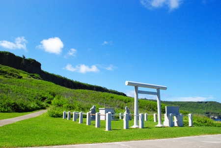 Memorial Shrine, Tinian Suicide Cliff The Japanese Memorial at the Suicide Cliff on Tinian, Northern Mariana Islands was erected to honor those who died in the island during the World War 11. The shrine is free of admission and is just right along the pat Stock Photo
