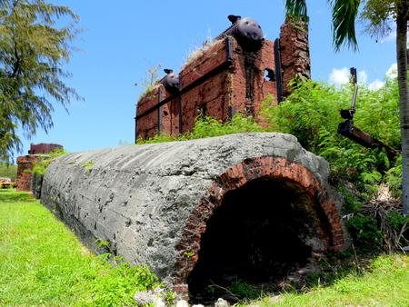 abandoned factory: Japanese sugar mill ruins, Rota Ruins of a pre-World War 11 (1930s) Japanese sugar mill in Songsong village, Rota, Northern Mariana Islands Editorial