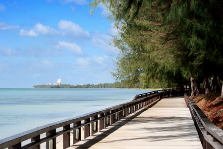 Walkway straight, Beach Road, Saipan The Beach Road walkway in Garapan is a favorite of many to walk, jog or run especially late in the afternoon or early morning. Stock Photo