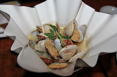 plating: Clam soup served in a stylish bowl, top view Clam soup is a favorite of many and a specialty in many restaurants.