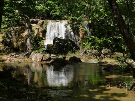 sooth: Price�s Falls reflected in the pool, Murray County, Oklahoma Price�s Falls in Murray County near Falls Creek, Oklahoma is named after William Nathan Price who built a grist mill in 1880�s. Stock Photo