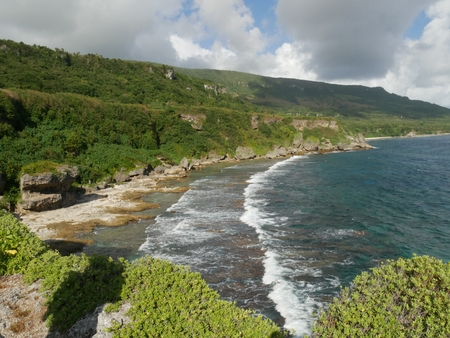 Gentle waves at Rota coastlines  Waves roll in gently toward the rocky shores of Rota, one of the islands of Northern Marianas known for pristine waters and breathtaking scenery.