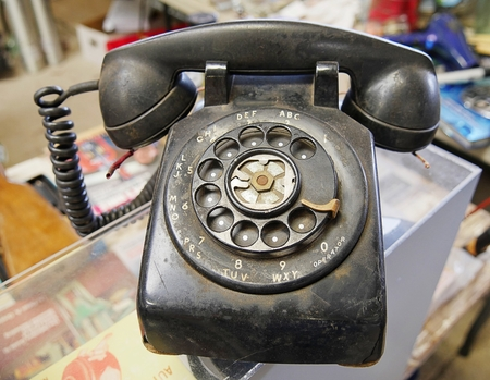 Old black dirty antique rotary style telephone