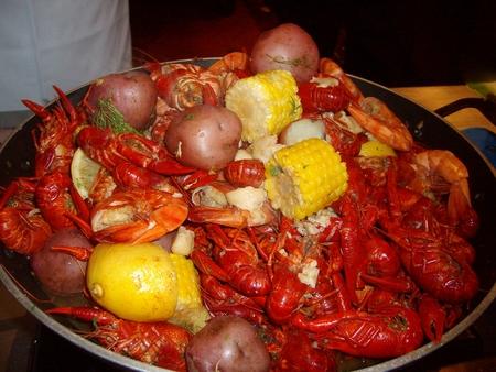 Crawfish and boiled shrimp, crawfish prawns corn cob and red potato, red beans and rice