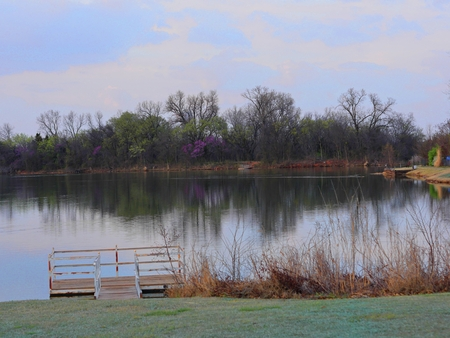 Cold afternoon by a lake in the early spring Stock Photo