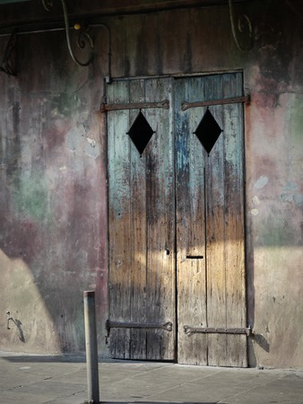 Vintage door design in a building by the sidewalk Stock Photo