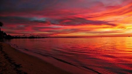 Reddish skies reflected on the waters of Garapan, Saipan, Northern Mariana Islands