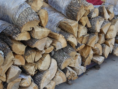 Pile of chopped firewood ready to be used for fireplaces and boilers