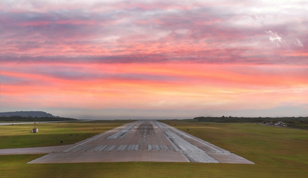 Saipan International Airport runway at sunset Stock Photo