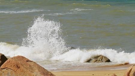 Foaming waves on the rocks