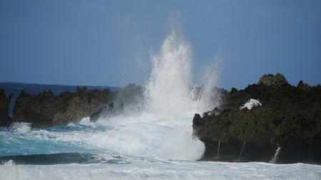 Huge waves slapping against sharp cliff lines create an amazing view