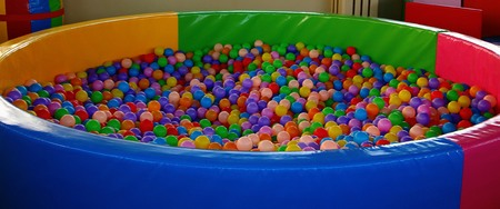 Big tub filled with colorful multi-colored balls in a children's playground
