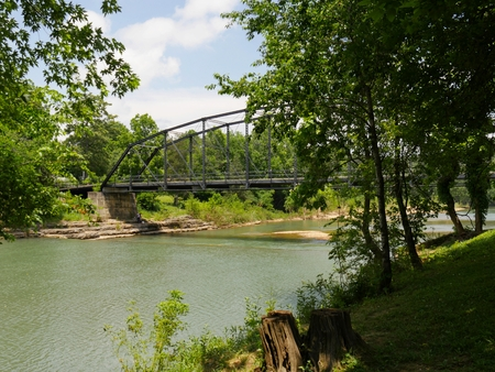 Side view of the War Eagle Mill bridge, a landmark in Rogers, and one of the most photographed in northwest Arkansas.