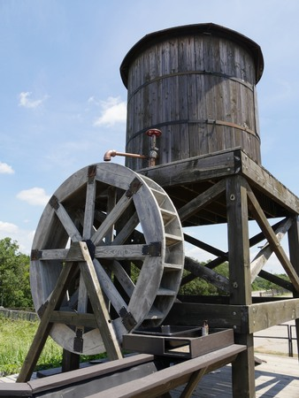 Closeup of an old wooden waterwheel with wooden tank Stock Photo - 117716881