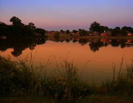 The magic hour after sunset casts a blissful atmosphere at the lakeside in Oklahoma.