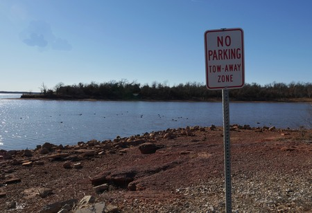 Lakeside with a No Parking sign at a tow-away zone, taken on a cold day Stock Photo