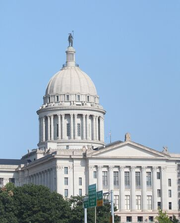 Medium wide shot of the Oklahoma State Capitol building in Oklahoma City, United States of America.