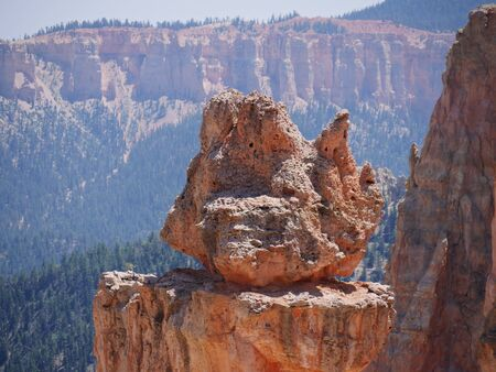 Close up of a red rock on top of a rock formation at Bryce Canyon National Park in Utah.