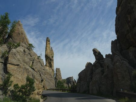 Spectacular rock formations and granite rock towers along the winding road at Needles Highway in South Dakota.