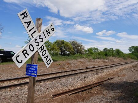 Close up of a crossing sign at a railroad track Stock Photo