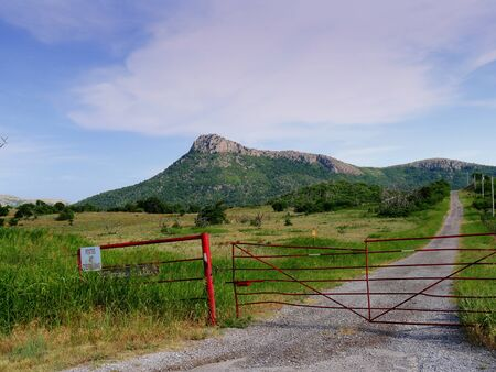 Fenced property with the Wichita Mountains in the background, Oklahoma.