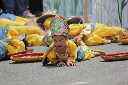 Davao City, Philippines-August 2014: Streetdancers at the Kadawayan festival parade in a lively performance for the competition. Kadayawan is celebrated August each year to give thanks for life and an abundant harvest. Sajtókép