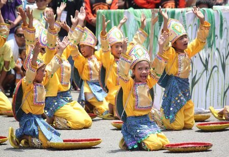 Davao City, Philippines-August 2014: Lively show from prformers at the Kadawayan festival streetdancing competition.  Kadayawan is celebrated August each year to give thanks for life and an abundant harvest. Sajtókép