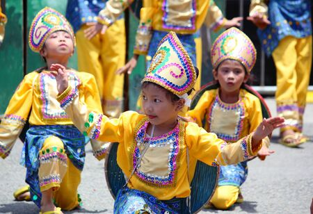 Davao City, Philippines-August 2014: Little performers at the Kadawayan festival for the streetdancing competition. Kadayawan is celebrated August each year to give thanks for life and an abundant harvest.
