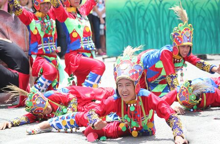 Davao City, Philippines-August 2014: Parade participants perform a lively presentation at the streetdancing competition. Kadayawan is celebrated August each year to give thanks for life and an abundant harvest.
