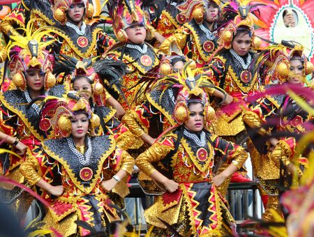 Davao City, Philippines-August 2014: Performers mesmerize the crowds with their colorful costumes and dancing at the street parade. Kadayawan is celebrated August each year to give thanks for life and an abundant harvest.