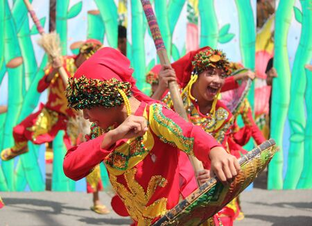 Davao City, Philippines-August 2014: Participants of the streetdancing parade perform a lively dance in the streets.  Kadayawan is celebrated August each year to give thanks for life and an abundant harvest.