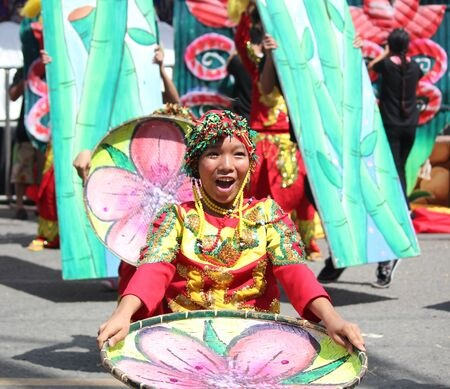 Davao City, Philippines-August 2014: A girl in colorful costumes is all smiles at a streetdancing performance.Kadayawan is celebrated August each year to give thanks for life and an abundant harvest.