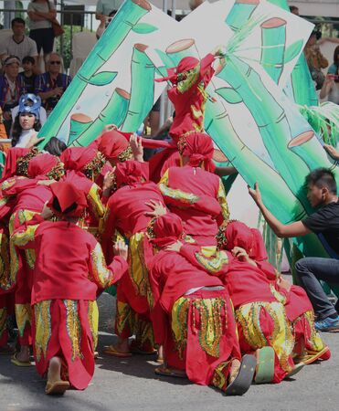 Davao City, Philippines-August 2014: Back view of street dancers in colorful costumes. Kadayawan is celebrated August each year to give thanks for life and an abundant harvest. 에디토리얼