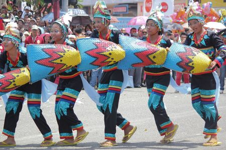Davao City, Philippines-August 2014: The Kadayawan festival streetdancing competition is one must-not-miss events in Davao City. Kadayawan is celebrated August each year to give thanks for life and an abundant harvest.