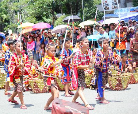 Davao City, Philippines-August 2014: Parade participants in colorful costumes performing at the streetdancing competition. Kadayawan is celebrated August each year to give thanks for life and an abundant harvest.