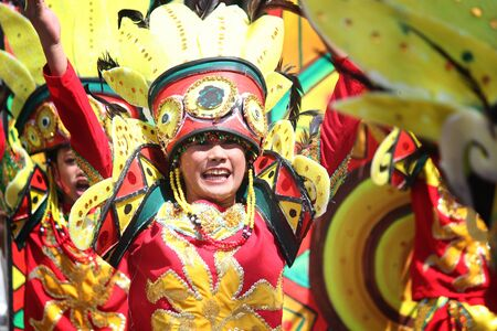 Davao City, Philippines-August 2014: Close up of a street dancing participants in colorful costumes. Kadayawan is celebrated August each year to give thanks for life and an abundant harvest.