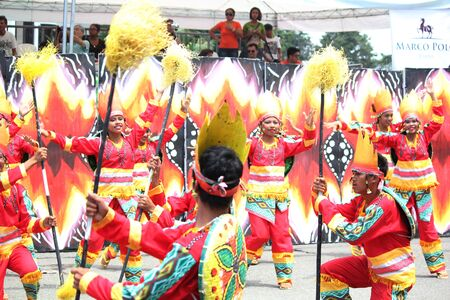 Davao City, Philippines-August 2014: Lively performance at the street dancing competition. Kadayawan is celebrated August each year to give thanks for life and an abundant harvest.