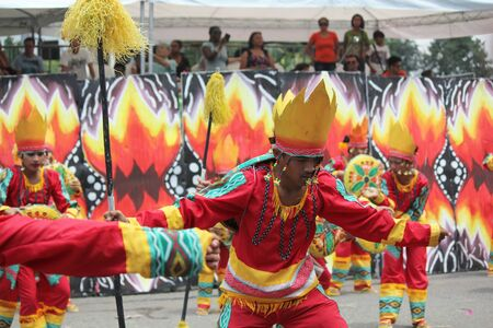 Davao City, Philippines-August 2014: Lively performance at the street dancing competition with crowds in the streetsides. Kadayawan is celebrated August each year to give thanks for life and an abundant harvest.