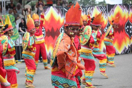 Davao City, Philippines-August 2014: Lively performance of street dancers at the Kadayawan festival. Kadayawan is celebrated August each year to give thanks for life and an abundant harvest.