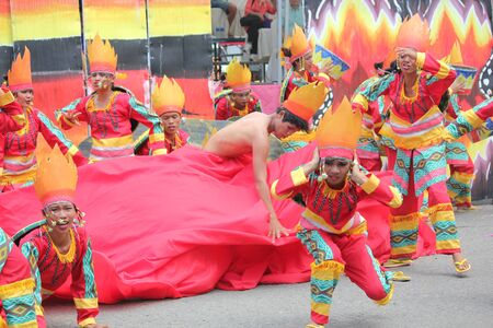 Davao City, Philippines-August 2014: Lively performance of street dancers in colorful props and costumes at the Kadayawan festival.  Kadayawan is celebrated August each year to give thanks for life and an abundant harvest.