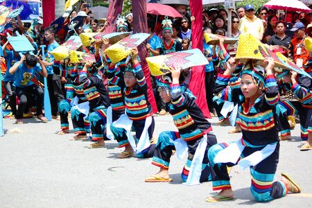 Davao City, Philippines-August 2014: Participants of the streetdancing competition perform a lively dance in the streets as the crowds look on from the sidelines. Sajtókép