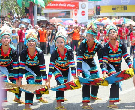 Davao City, Philippines-August 2014: Participants of the streetdancing competition perform a lively dance in the streets. Kadayawan is celebrated August each year to give thanks for life and an abundant harvest.